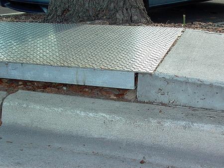 Metal bridging over sidewalk